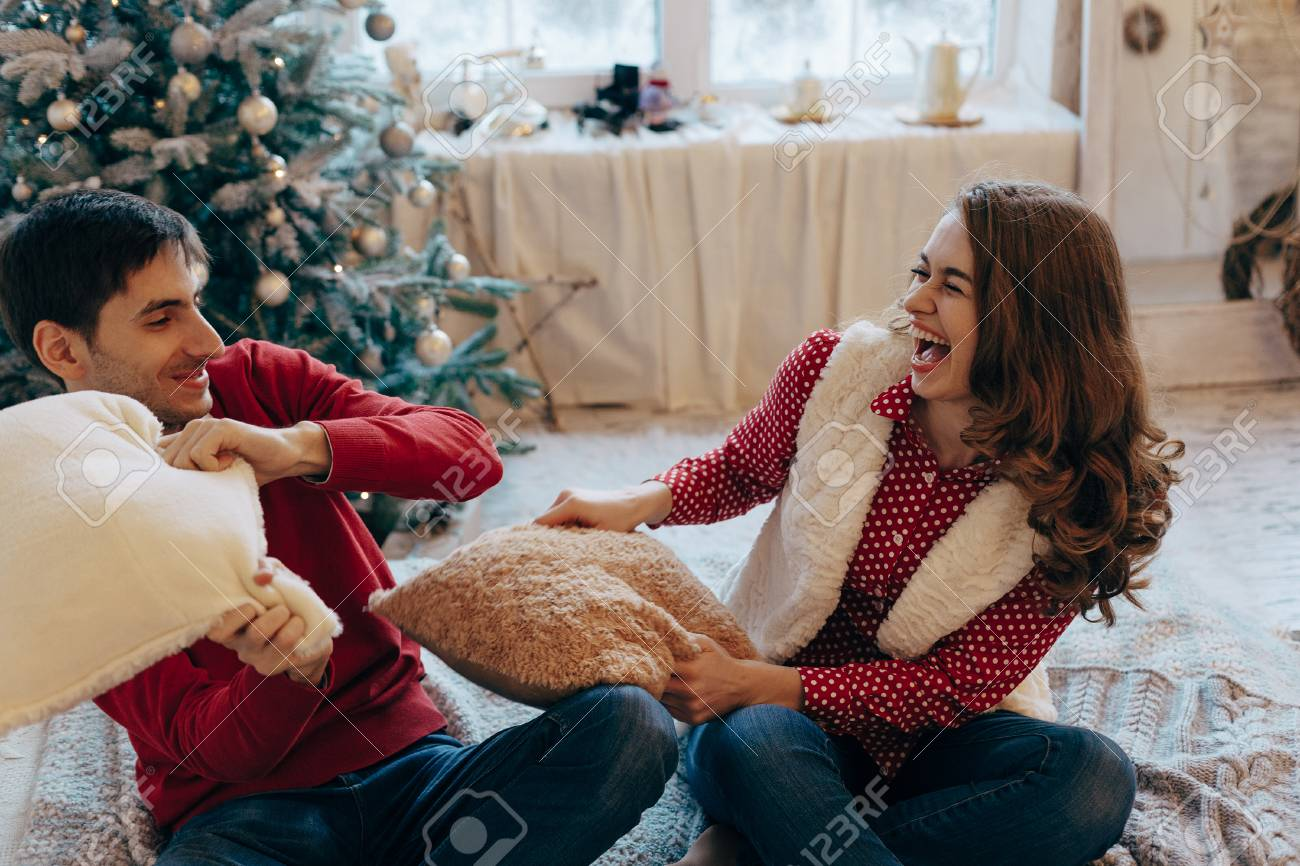 Crazy For Christmas.Happy Loving Caucasian Couple Is Getting Crazy On The Christmas