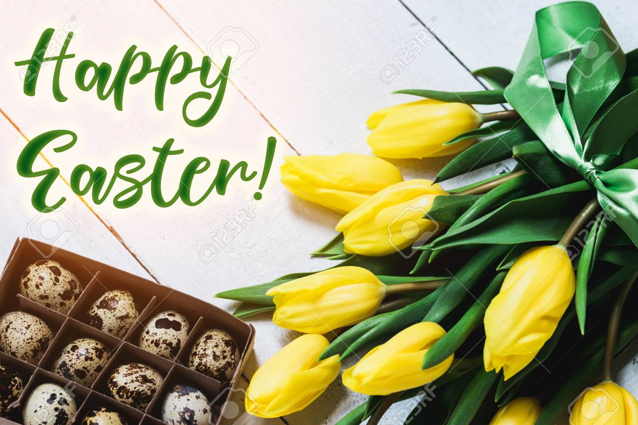 836bf3cd6631d Easter spring decorative composition. Bouquet of yellow tulips tied by  green ribbon and little box