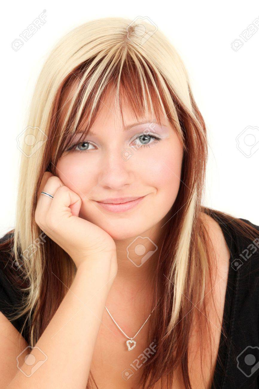 Portrait of young smiling blonde woman, studio shot Stock Photo - 6708604