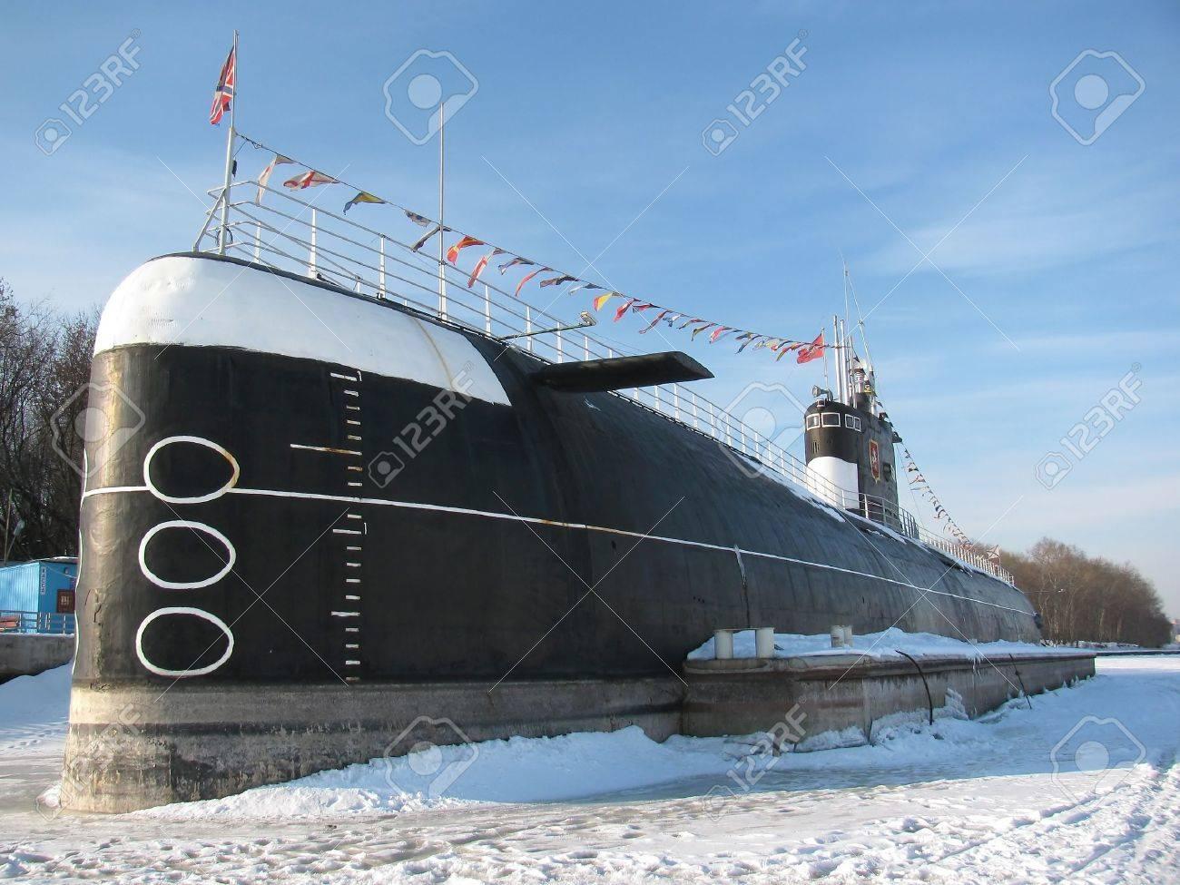 Submarine in dock. Frozen in ice - 4424998