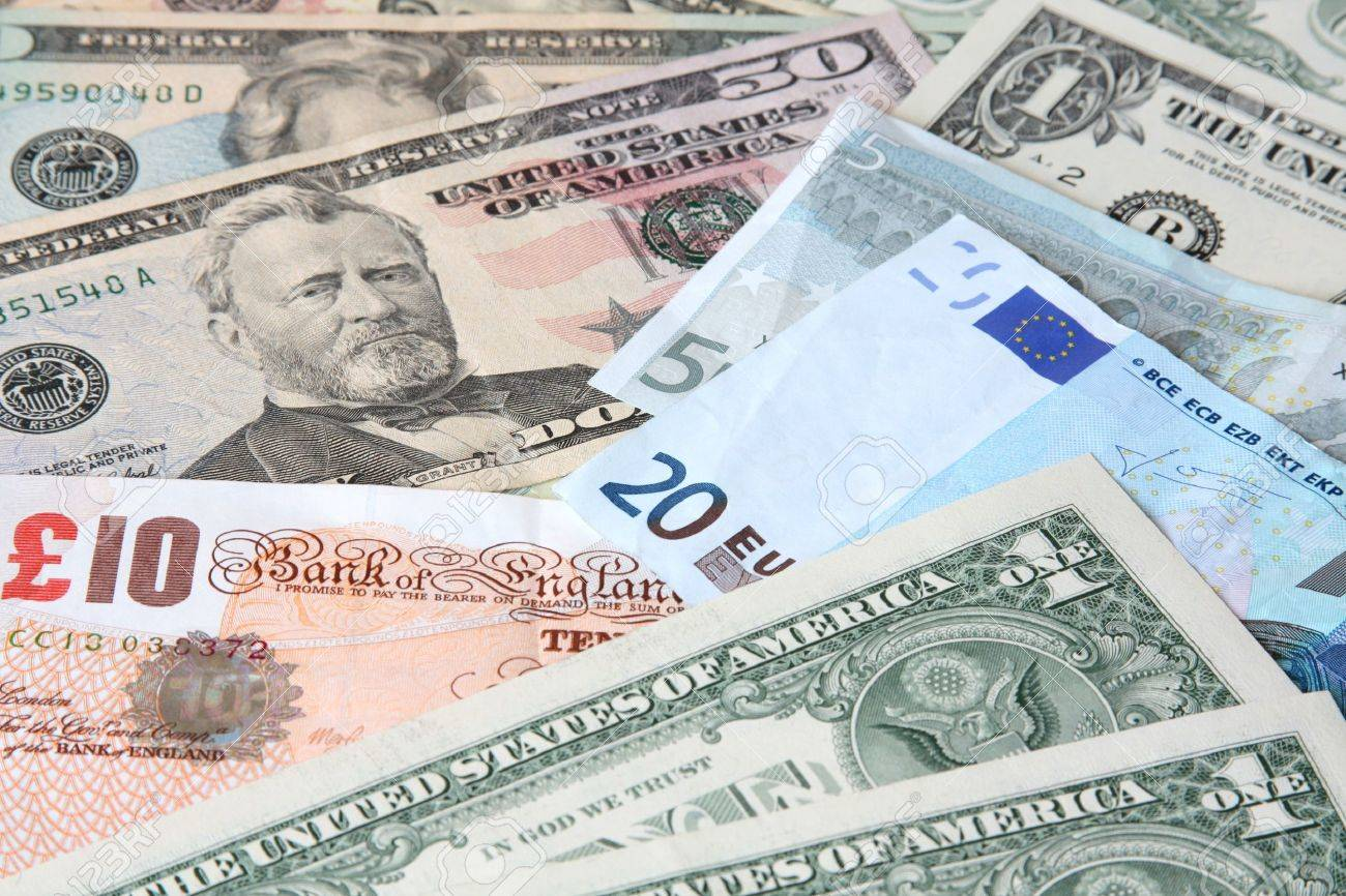 Money. World currencies: U.S. dollars, pounds and euros. Banknotes. - 4450433