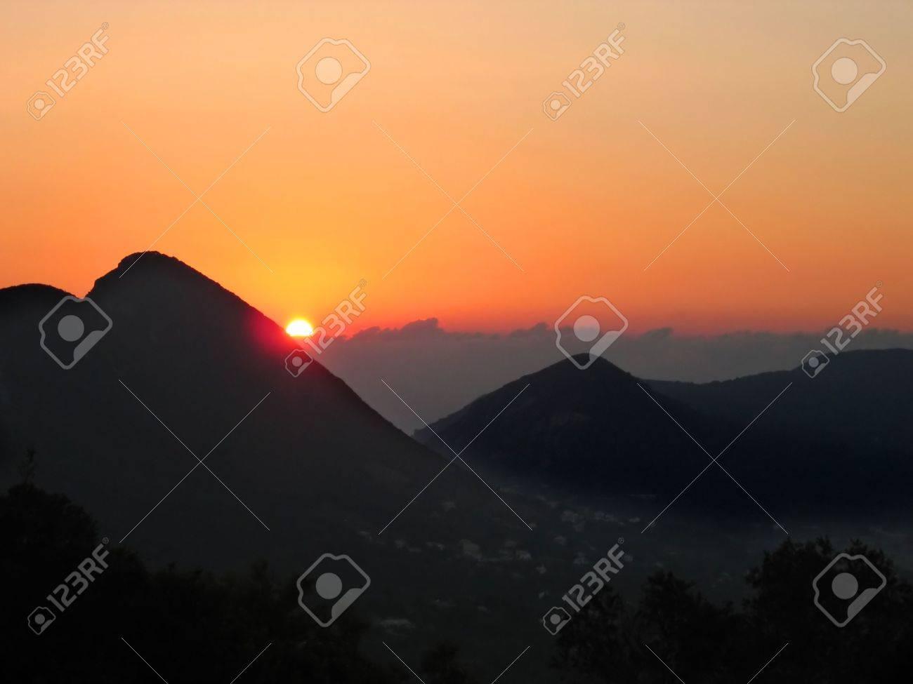 Orange sunset in the mountains. Corfu island, Greece - 5210170