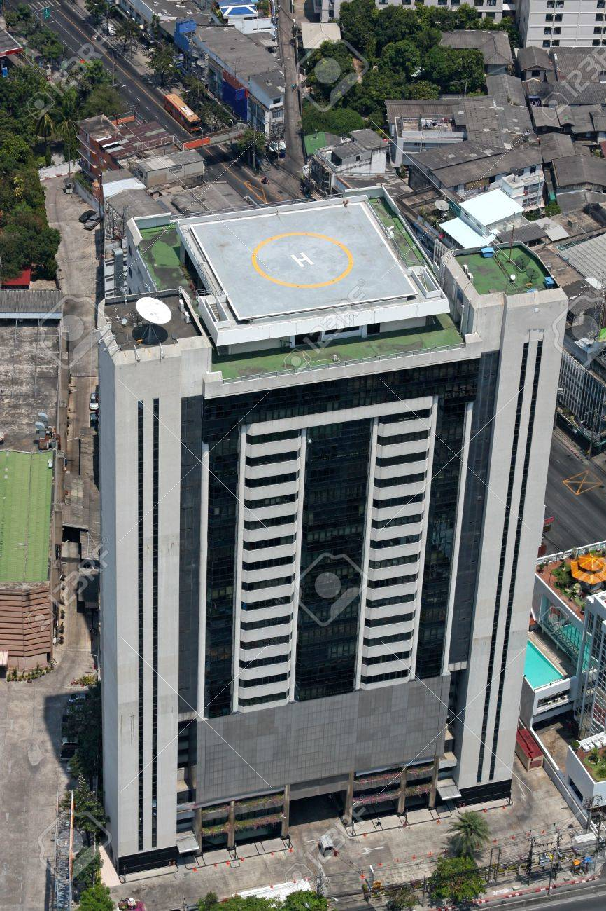 Office building with a helipad on the roof. Top view - 7788791