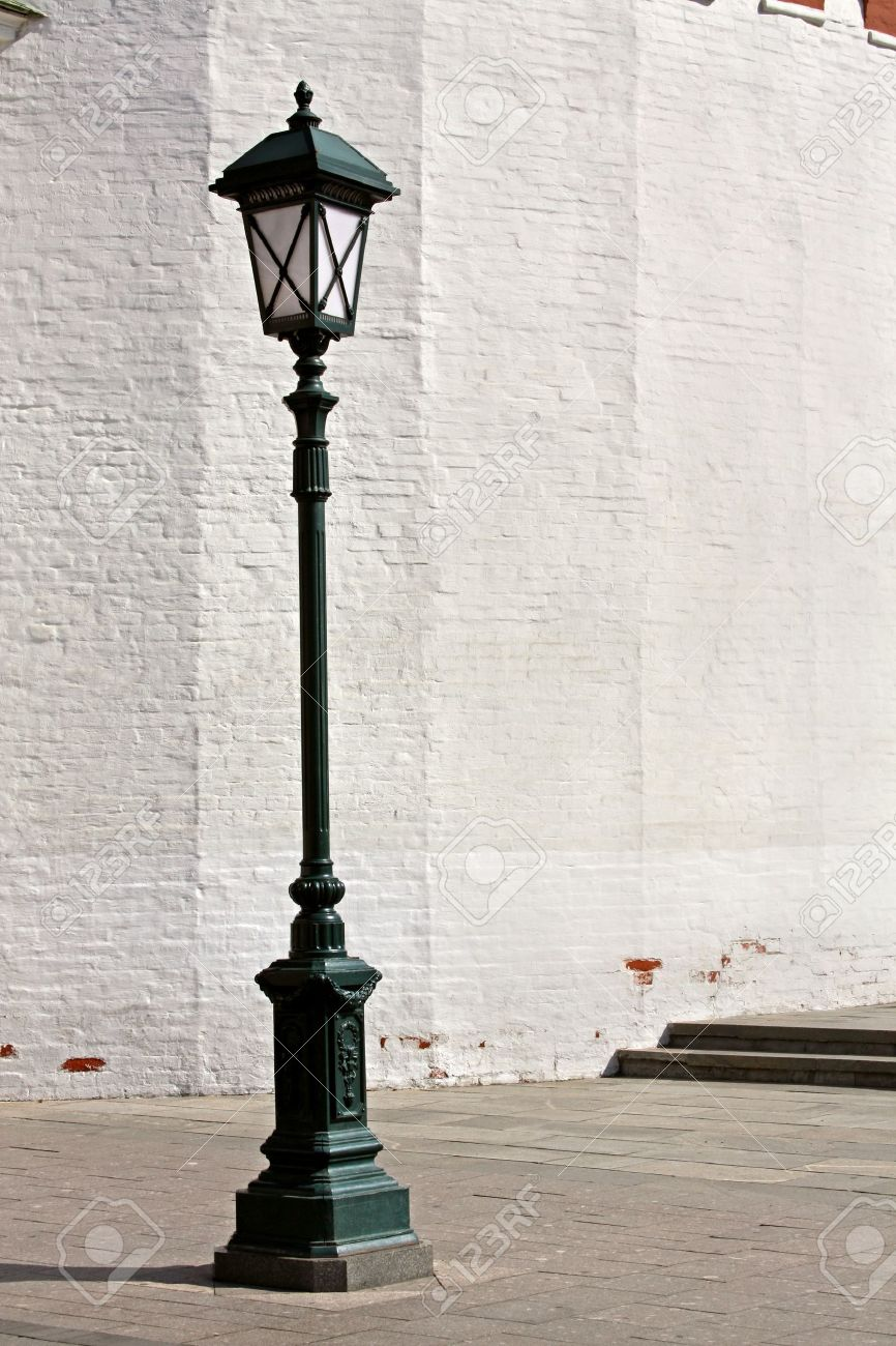 Old Style Street Lamp In Front Of The Wall Of White Brick Stock ... for Street Lamps Photography  174mzq