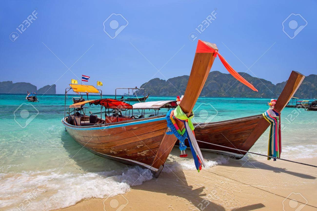 Longtail boats landing at Railay bay, Krabi province, Thailand - 30568146