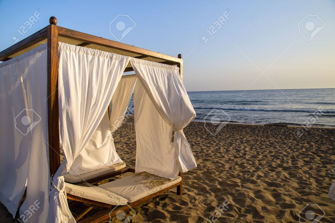 White beach canopies. Luxury beach tents at a resort Stock Photo - 65812195 & White Beach Canopies. Luxury Beach Tents At A Resort Stock Photo ...