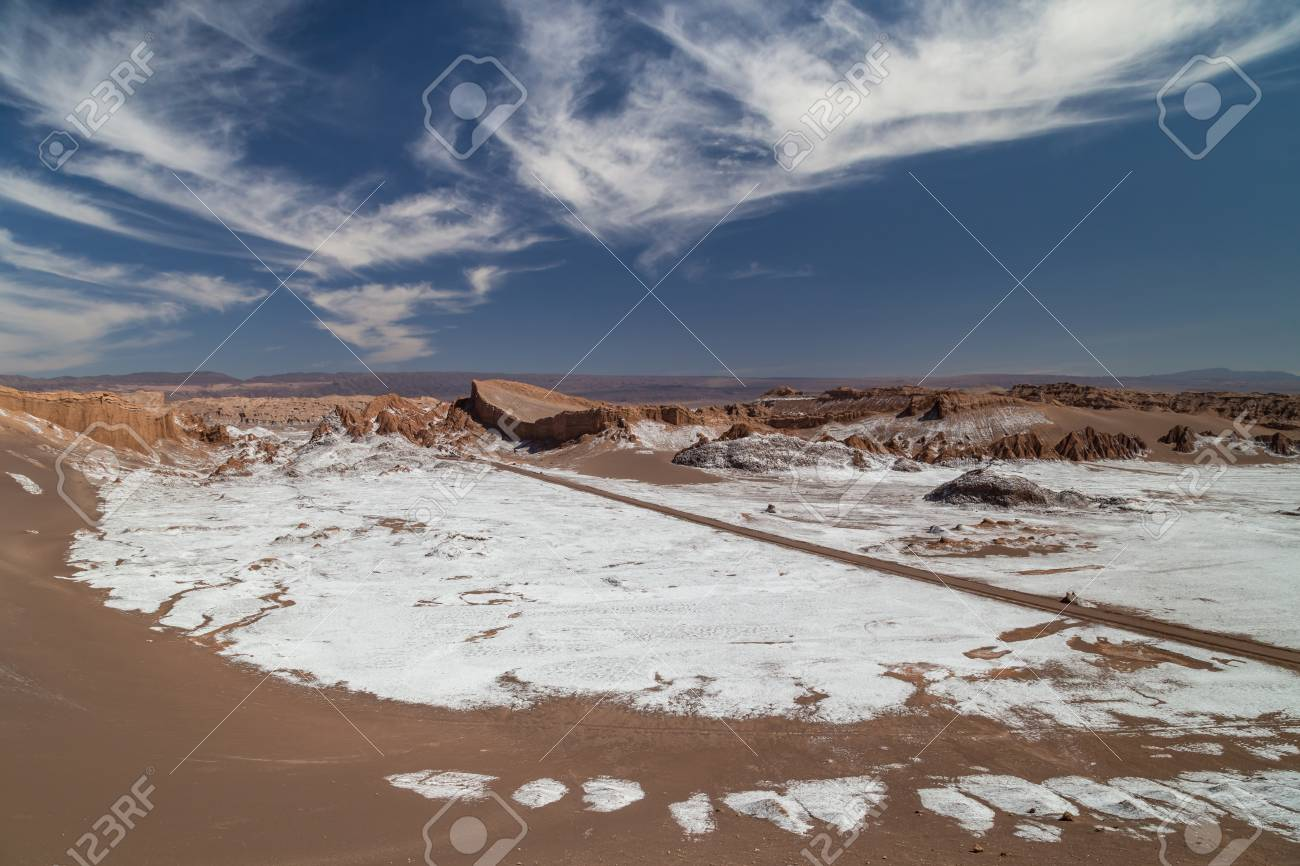 Dunes and rock formations covered with dry salt in Valle de la Luna, Atacama, Chile - 115409177