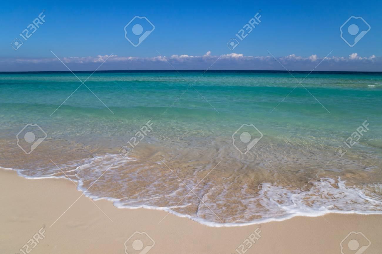 Soft wave on a white sand beach - 115409180