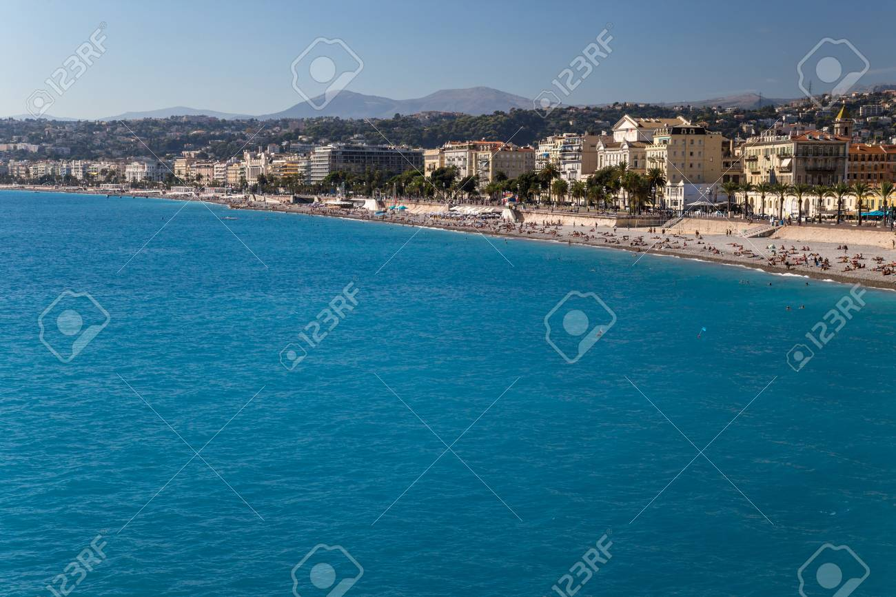 View to a beach and a city. Nice, French Riviera - 115409506