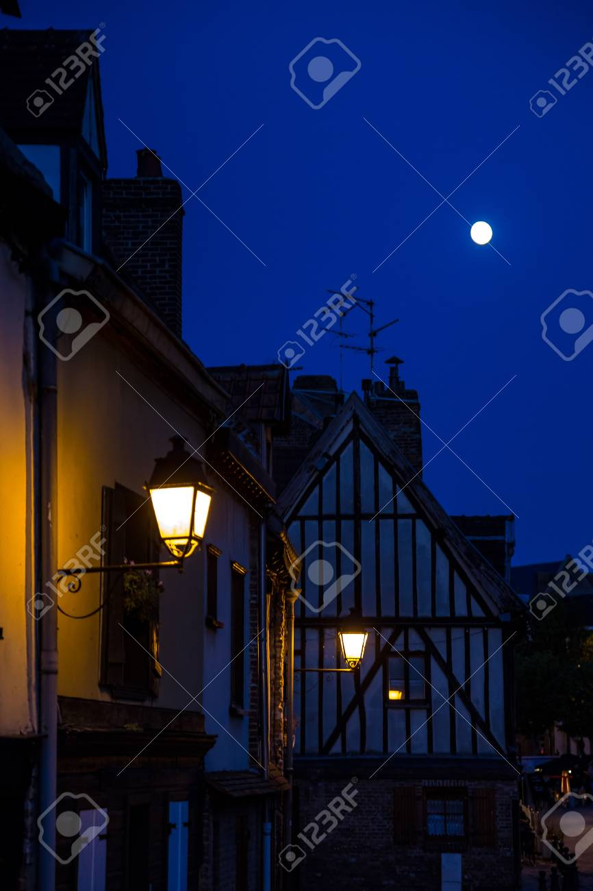 Night scene with the moon and lanterns. Old street in historical part of Amiens, France - 115410239