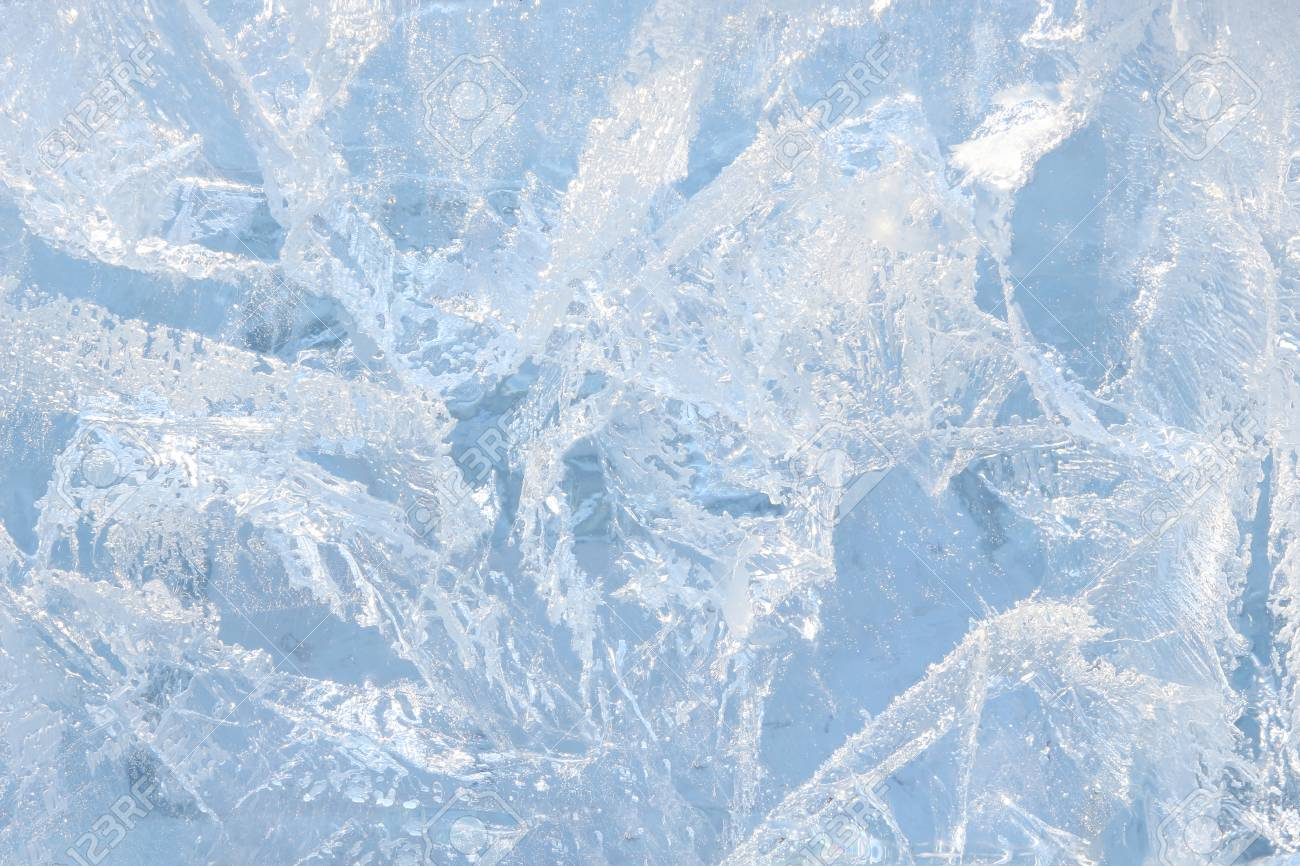 Full frame ice background. Backlit with the sun - 115410351