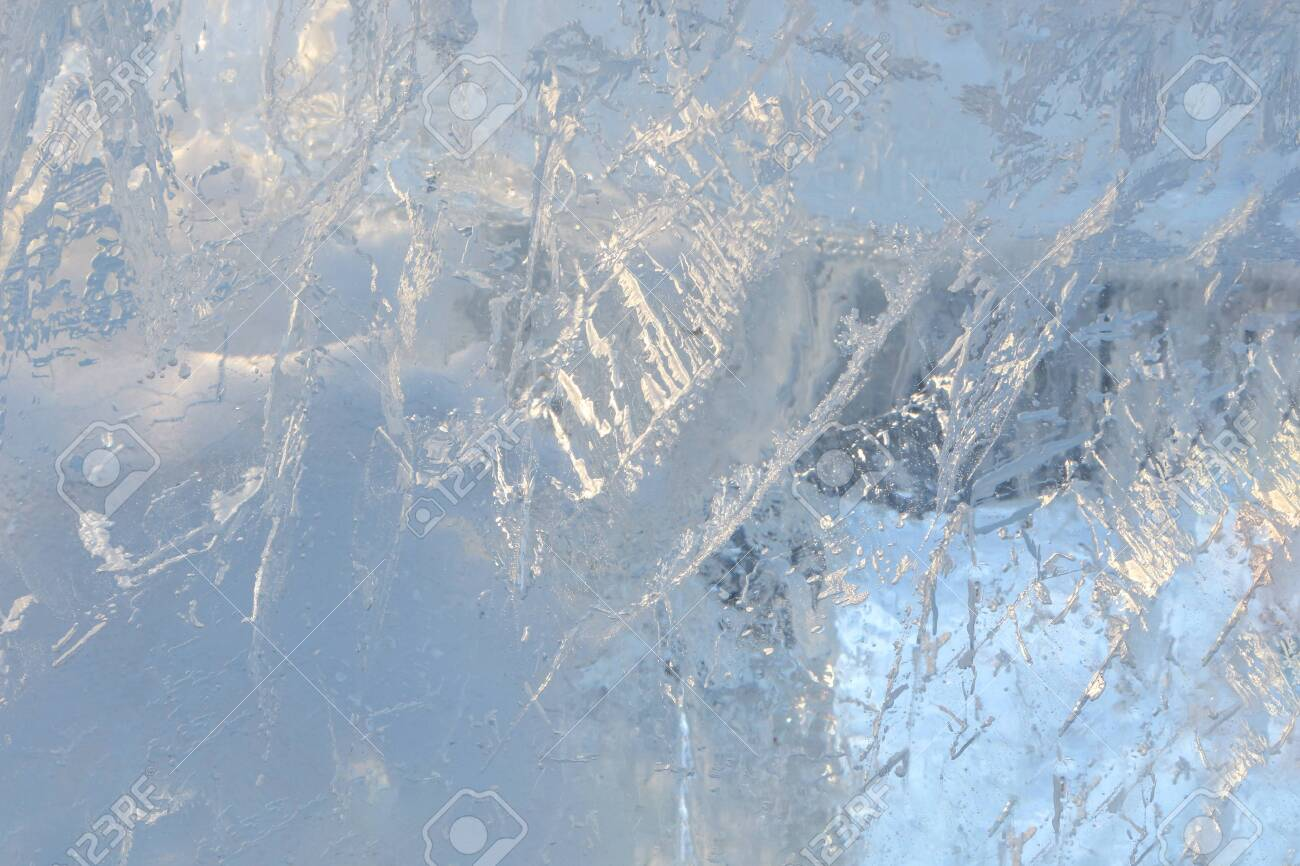 Full frame ice background. Backlit with the sun - 115410352