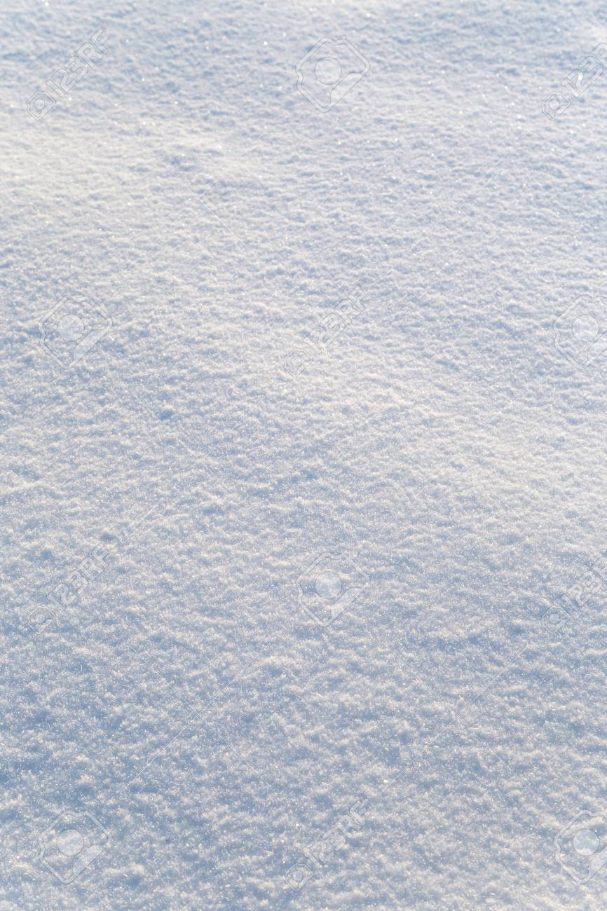 Background of white snow sparkling in the sun. Shallow depth of field - 115410369