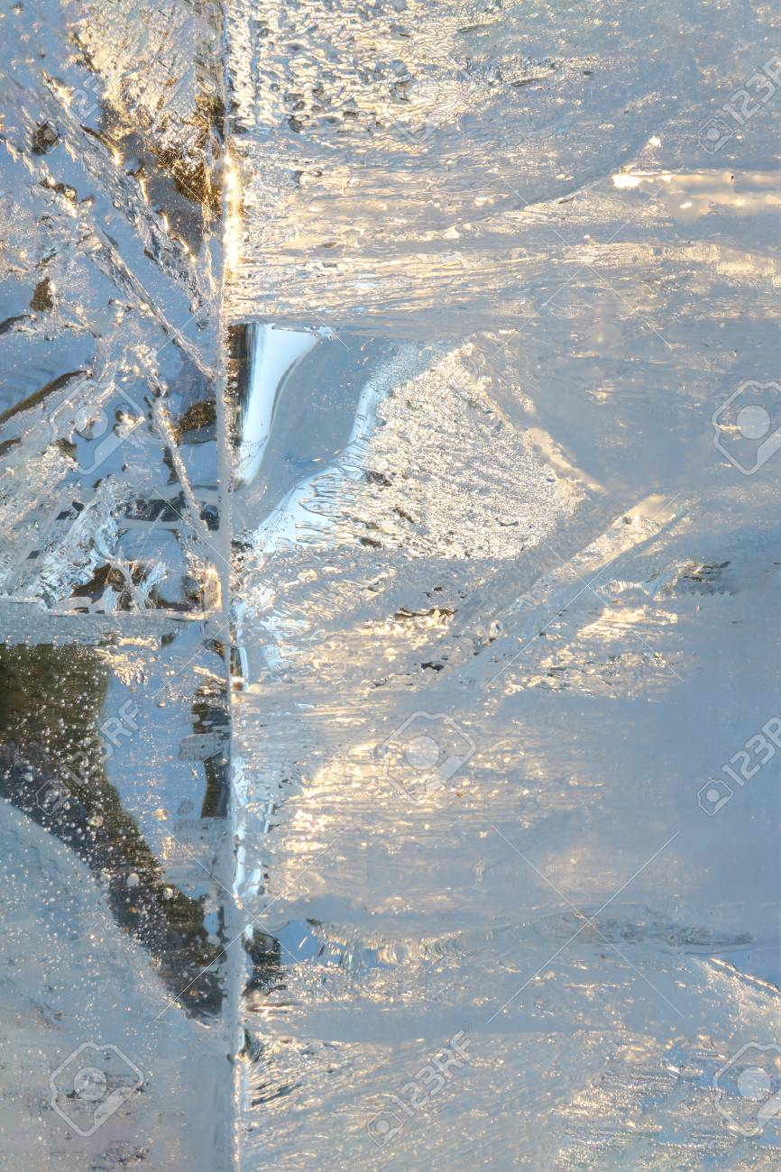 Full frame ice background. Backlit with the sun - 115410405