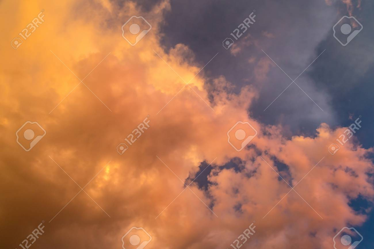 Dramatic clouds at colourful moody sunset - 116426905
