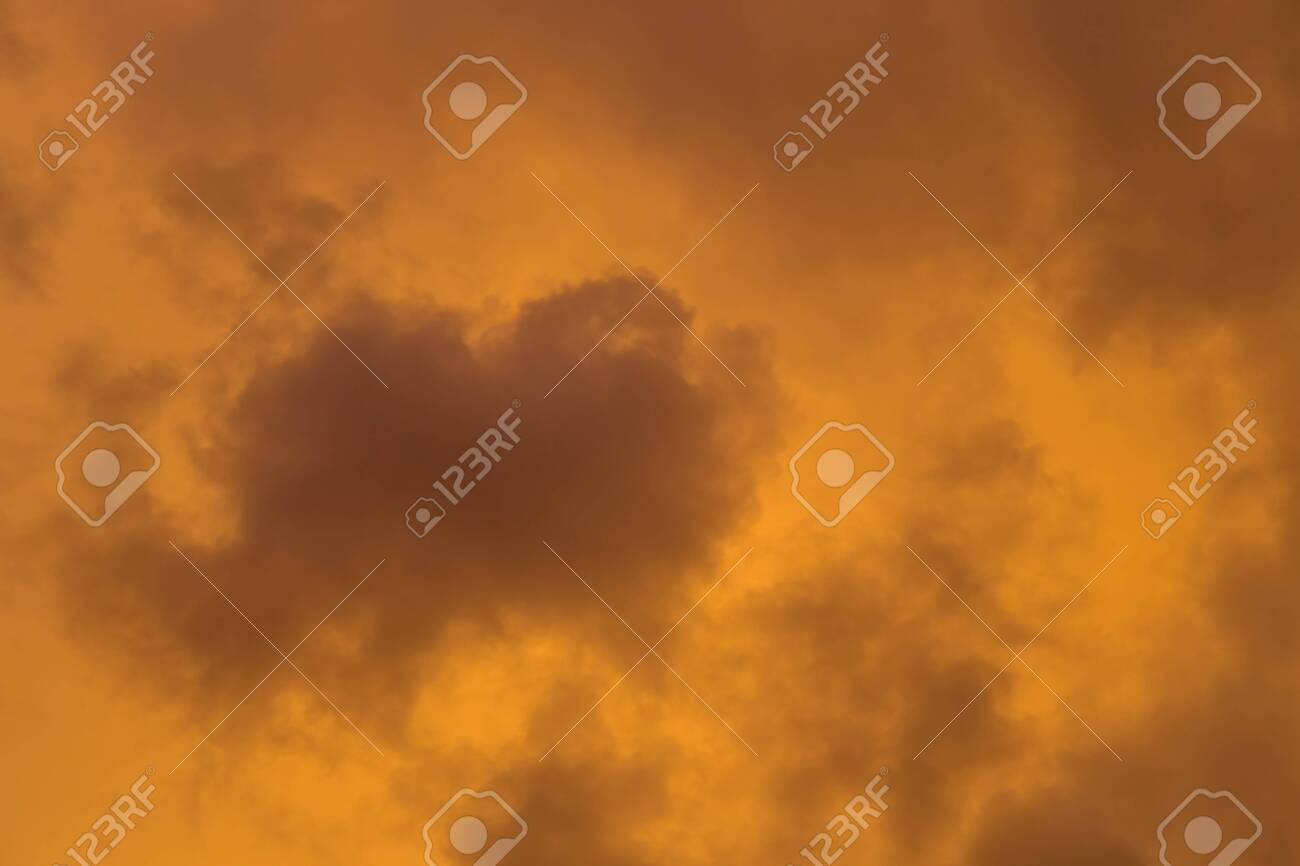 Dramatic clouds at colourful moody sunset - 116426961