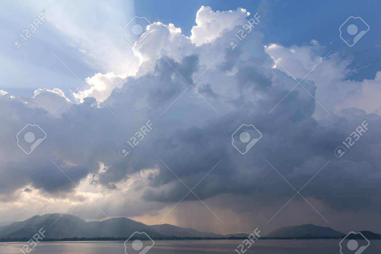 Dramatic clouds early in the morning. View to a tropical island - 127056737