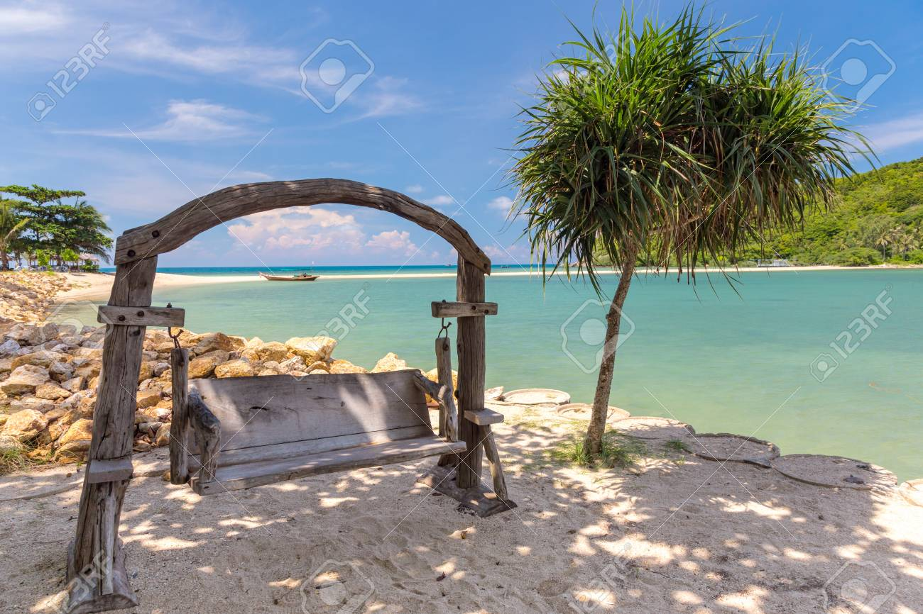 Wooden swinging bench on a beach. Thailand - 127056885