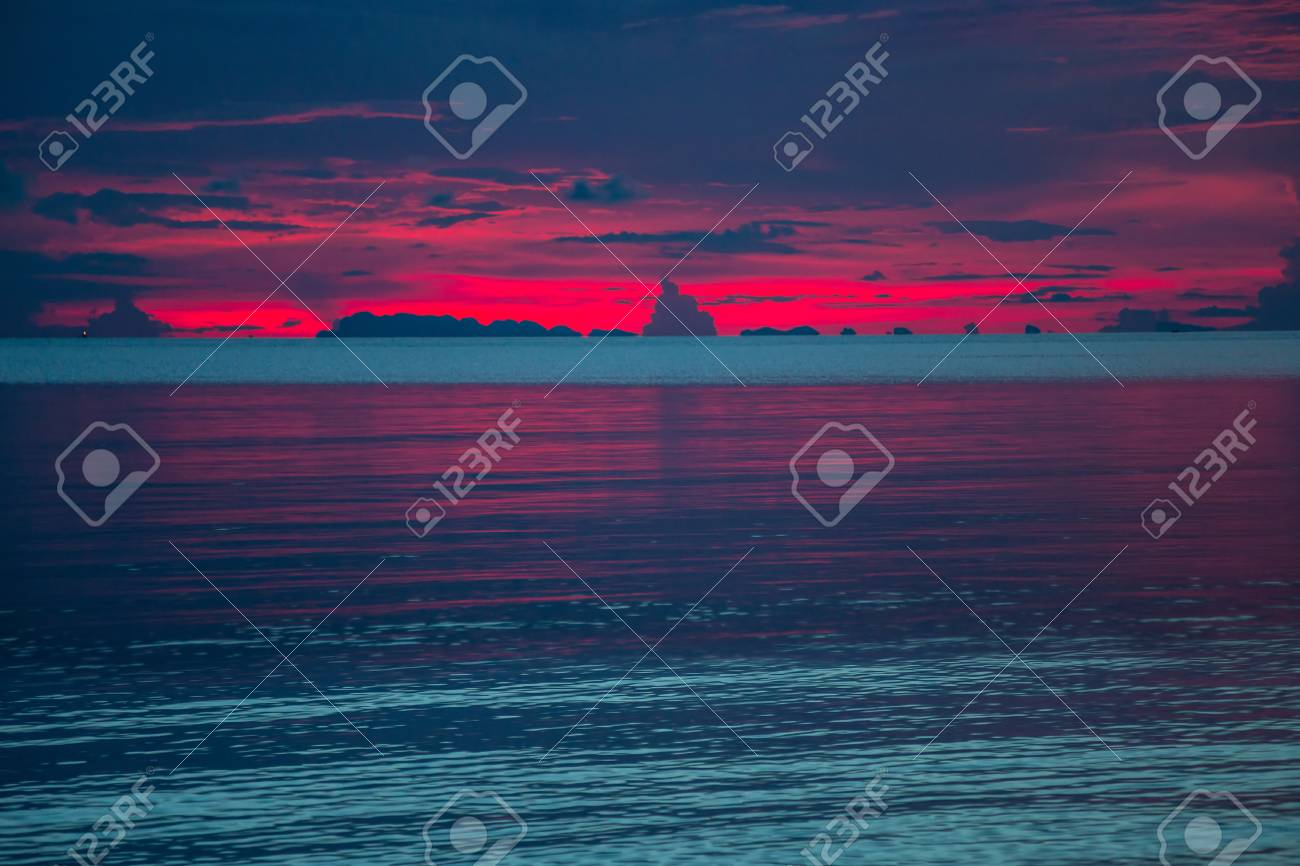 Colorful sunset over the sea. Dark dramatic sky - 127056894
