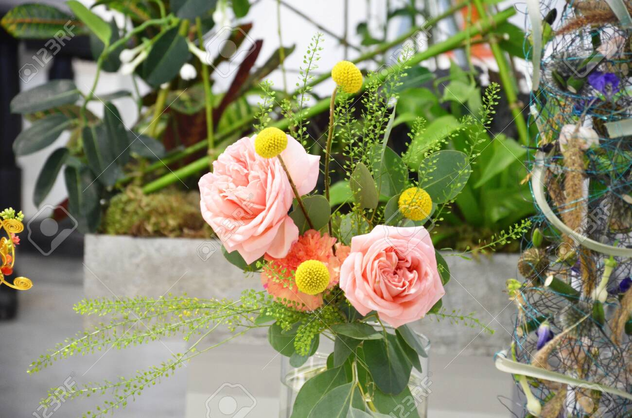 Floral shop concept Florist creates flower in a wicker basket. Beautiful bouquet mixed flowers. fresh bunch. Flowers delivery. Colorful bouquet of different orchids, roses, freesia eucalyptus leaves - 147236859