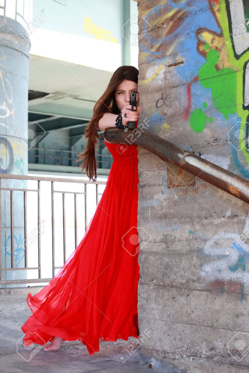 Beautiful Girl In A Red Dress With Gun Stock Photo, Picture And ...