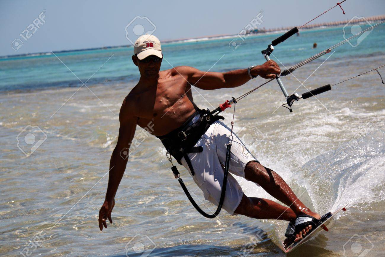 Unidentified man kitesurfing in Red Sea waters in Egypt, Sharm-El-Sheikh on April 24, 2010 Stock Photo - 9687273