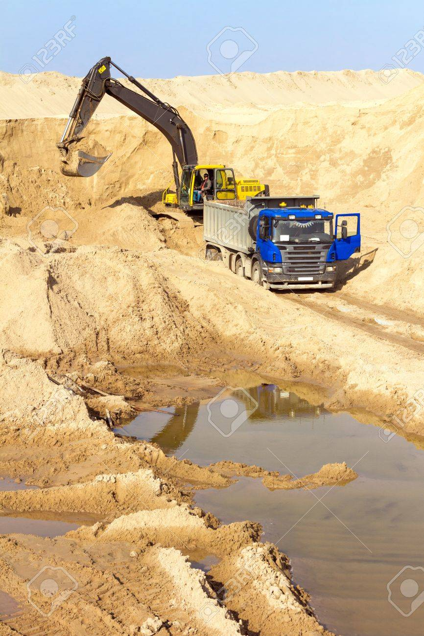 Excavator Loading Dumper Truck at Construction Site Stock Photo - 19248106
