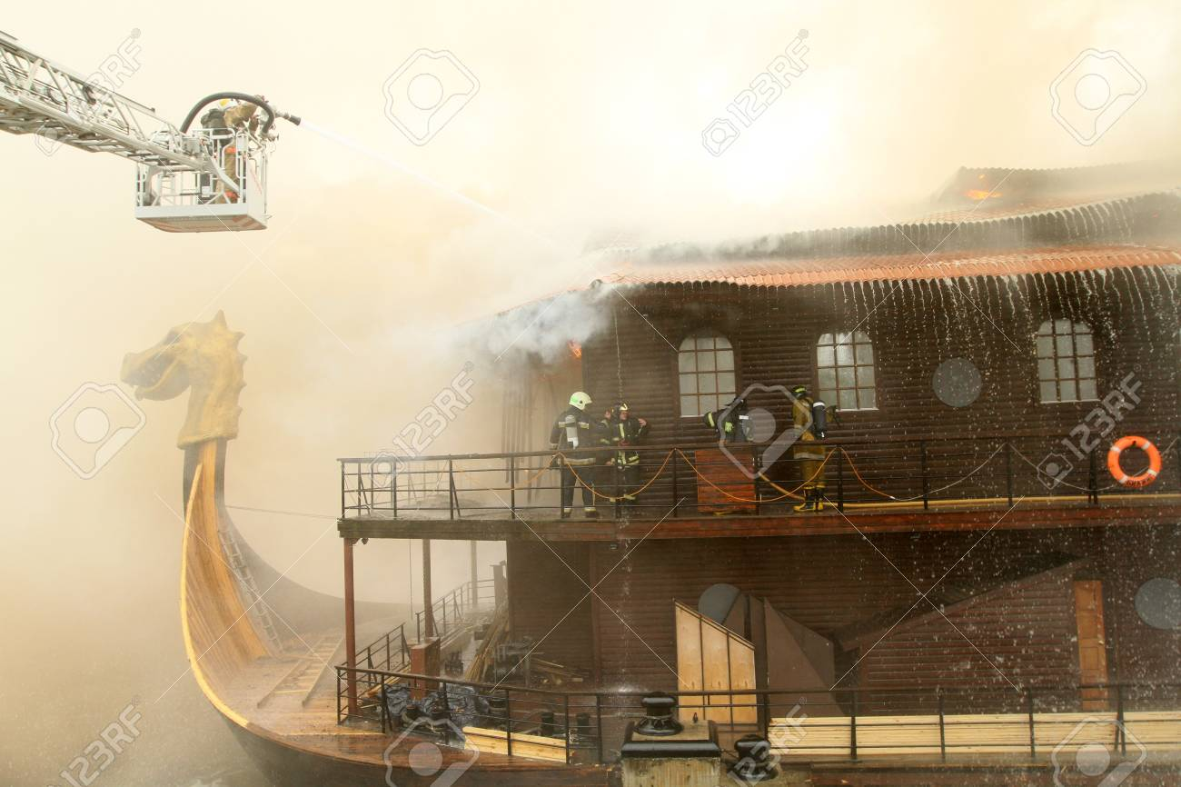 MOSCOW - APRIL 30: Firefighters extinguishing fire at the Viking floating restaurant on the Berezhkovskaya embankment, April 30, 2010 in Moscow, Russia. Stock Photo - 7571941