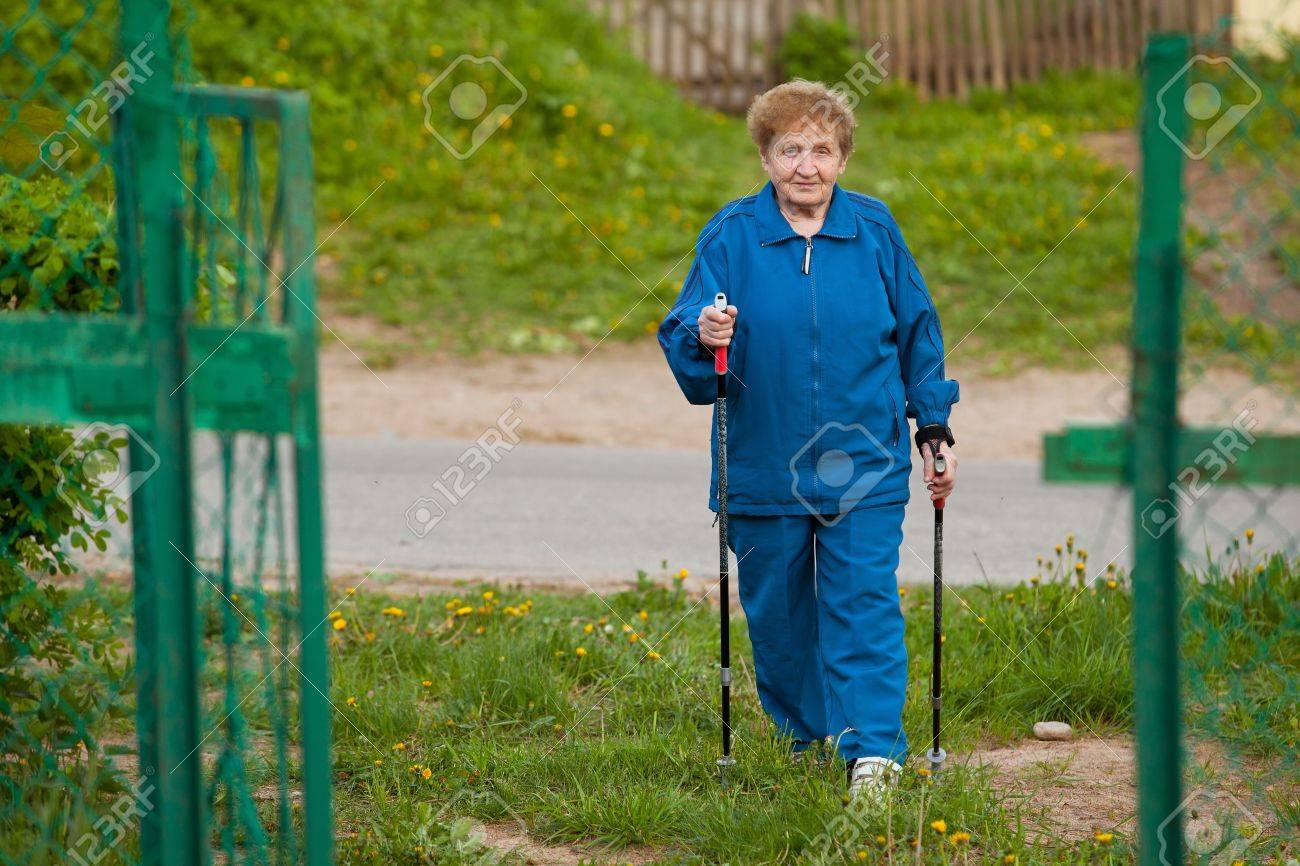 Active old woman nordic walking outdoors (85 years old) . Stock Photo - 14528278