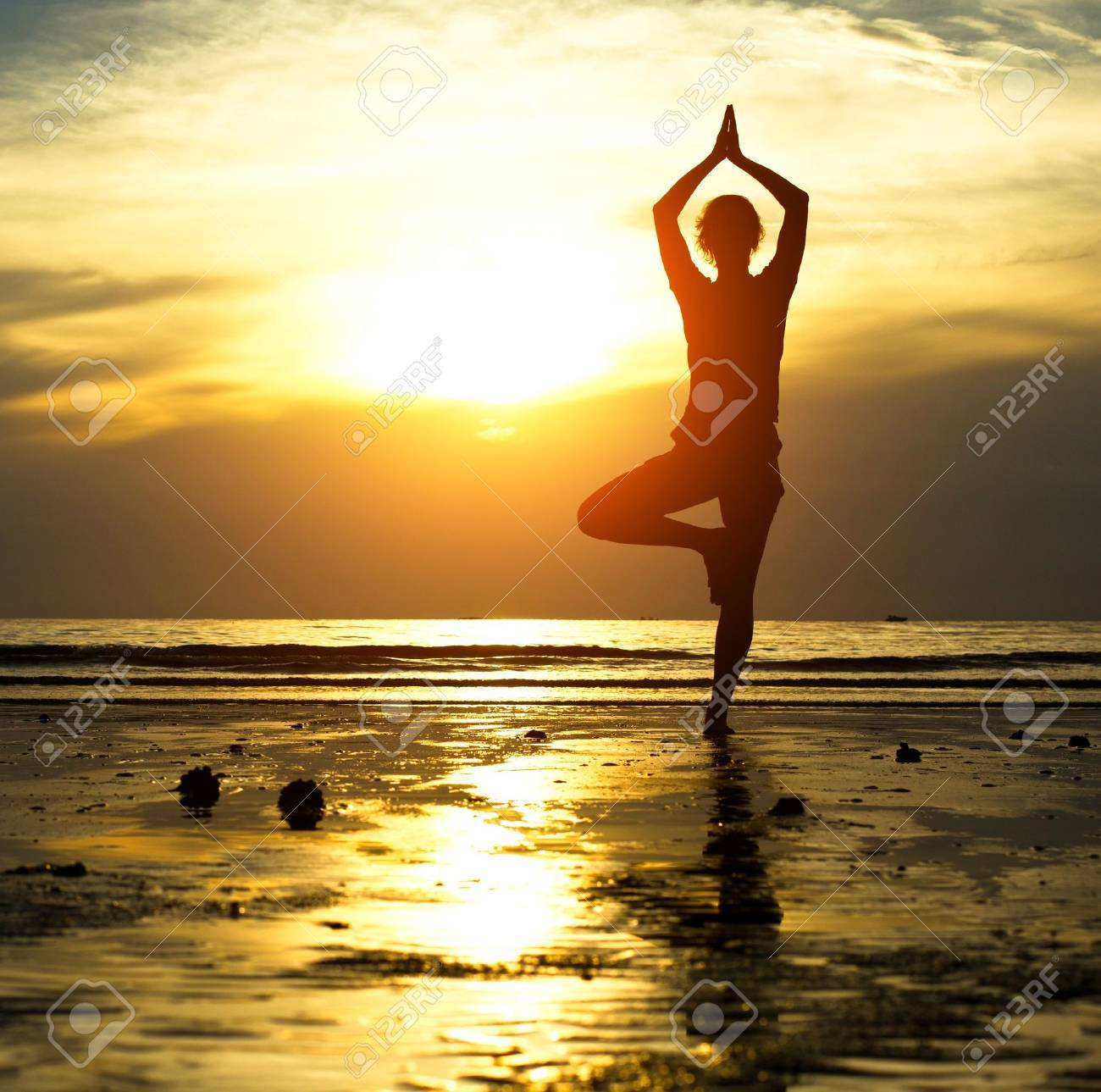 Silhouette of a beautiful yoga woman in the evening Stock Photo - 16693670