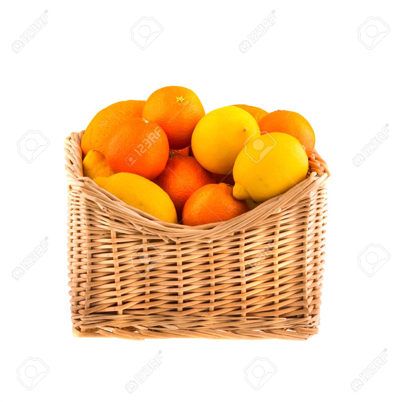 Oranges and lemons in a wooden basket, isolated on white background. Stock Photo - 26568135