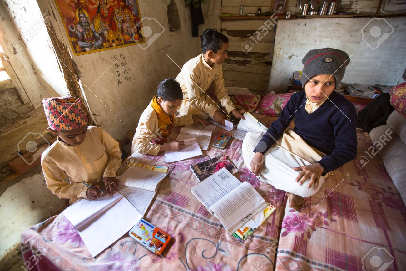 KATHMANDU, NEPAL - DEC 9, 2013: Unknown children doing homework at Jagadguru School. School established at 2013, to let new generation learn Sanskrit and preserve Hindu culture. Stock Photo - 26842381