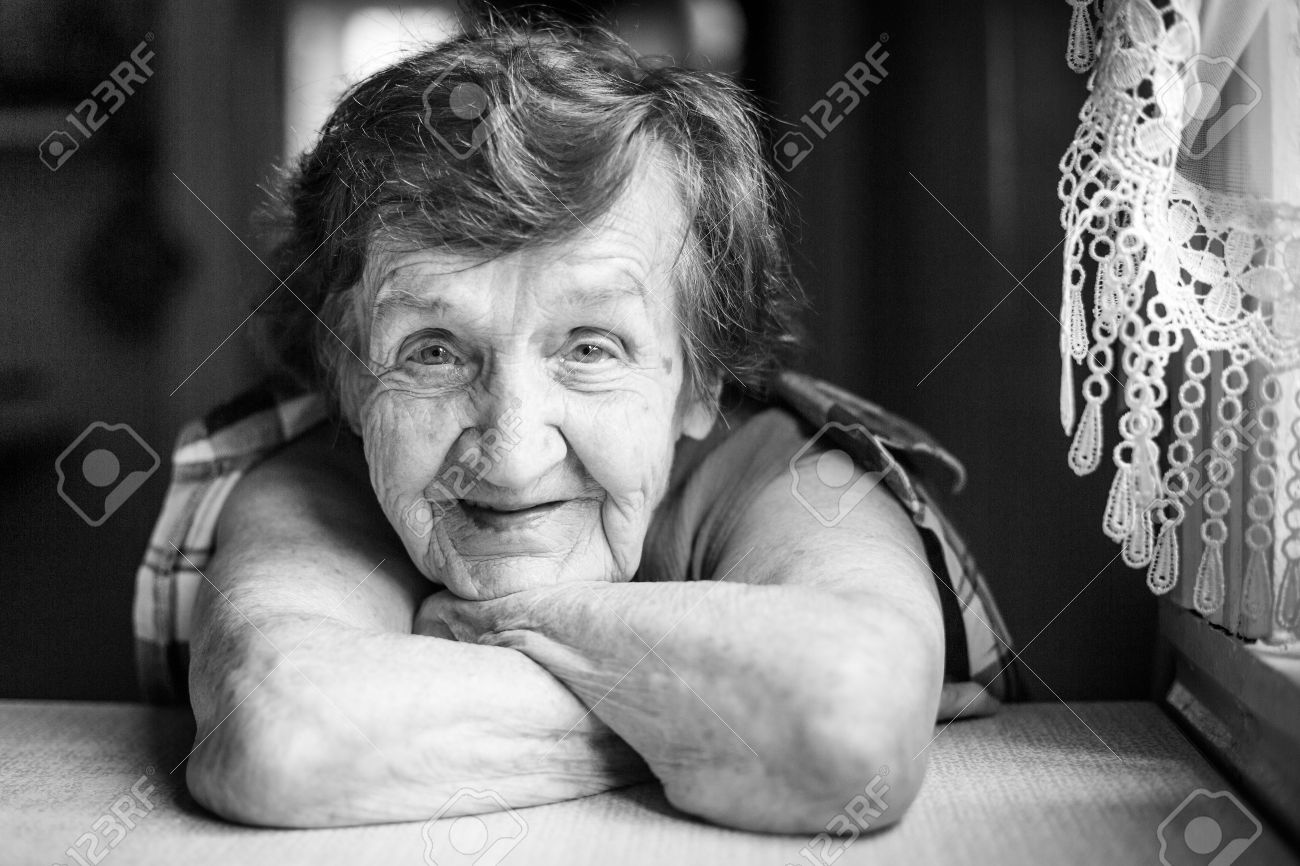 Portrait of a smiling old woman black and white photo stock photo 30801270