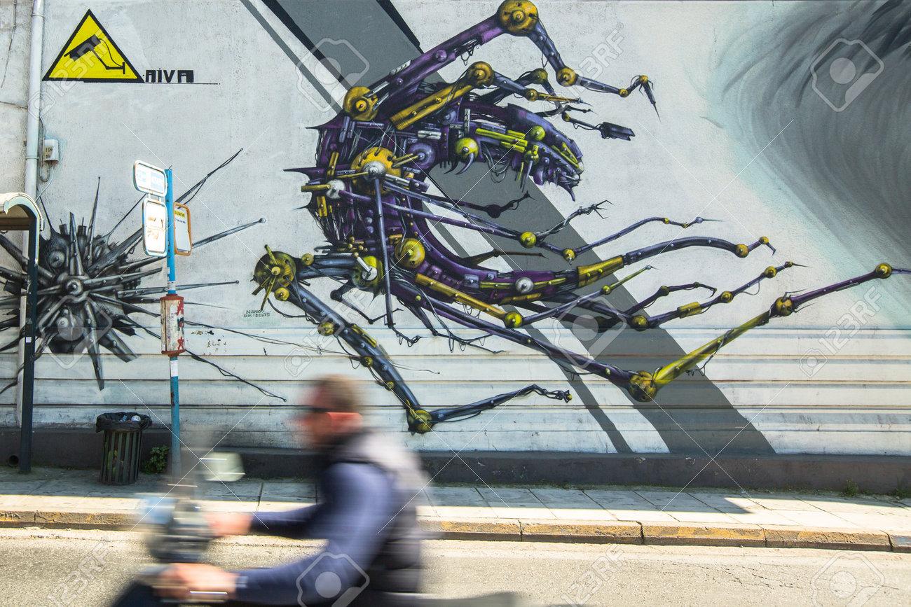 http://previews.123rf.com/images/dimaberkut/dimaberkut1504/dimaberkut150400053/38255815-ATHENS-GREECE-APR-3-2015-Contemporary-graffiti-art-on-city-walls-Hardships-of-Greek-economic-crisis--Stock-Photo.jpg