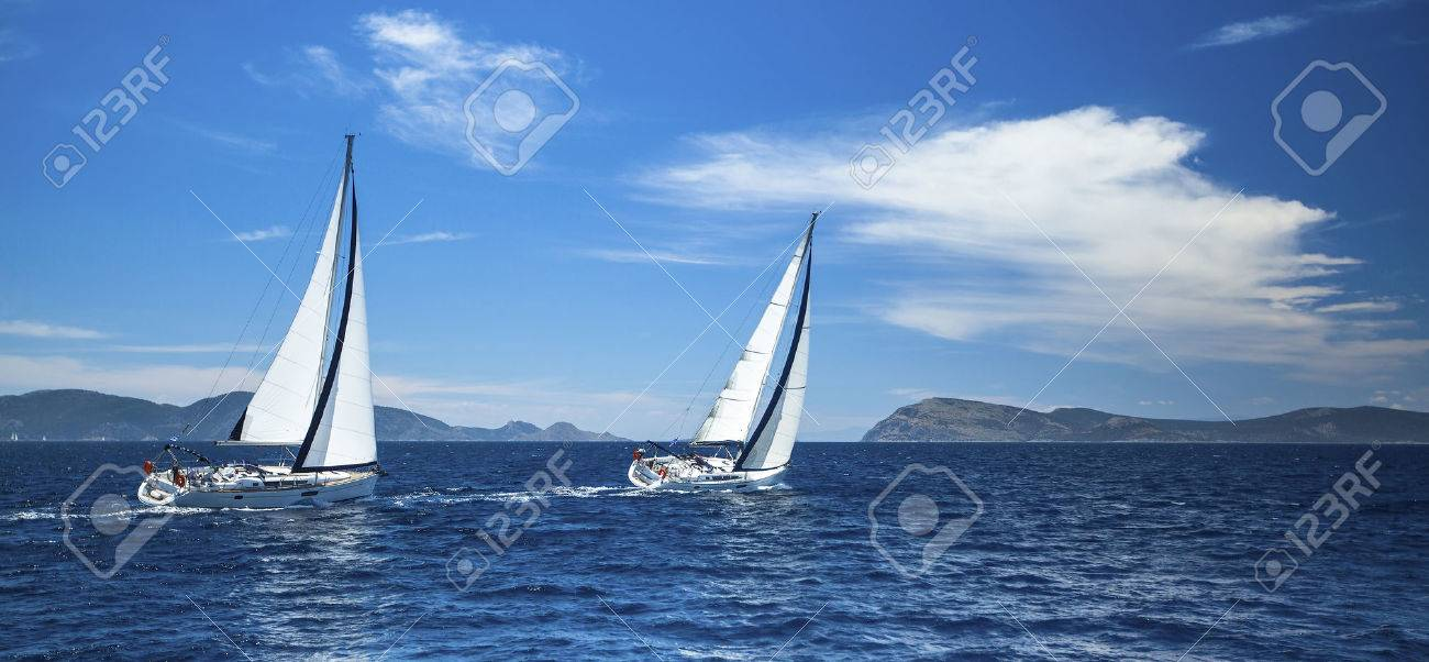 Sailing in the wind through the waves at the Aegean Sea in Greece. - 39326686