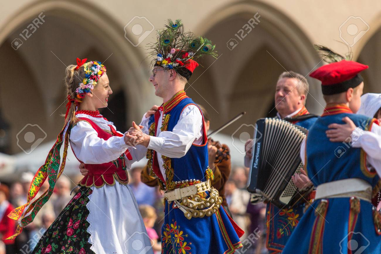 KRAKOW, POLAND - MAY 3, 2015: Polish folk collective on Main square during annual Polish national and public holiday the Constitution Day - May 3, 1791 was adopted first Constitution of modern Europe. - 39532542