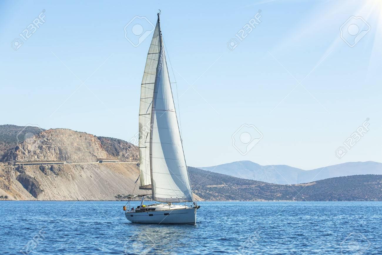 Sailing  Yacht sails with beautiful sky  Luxury yacht