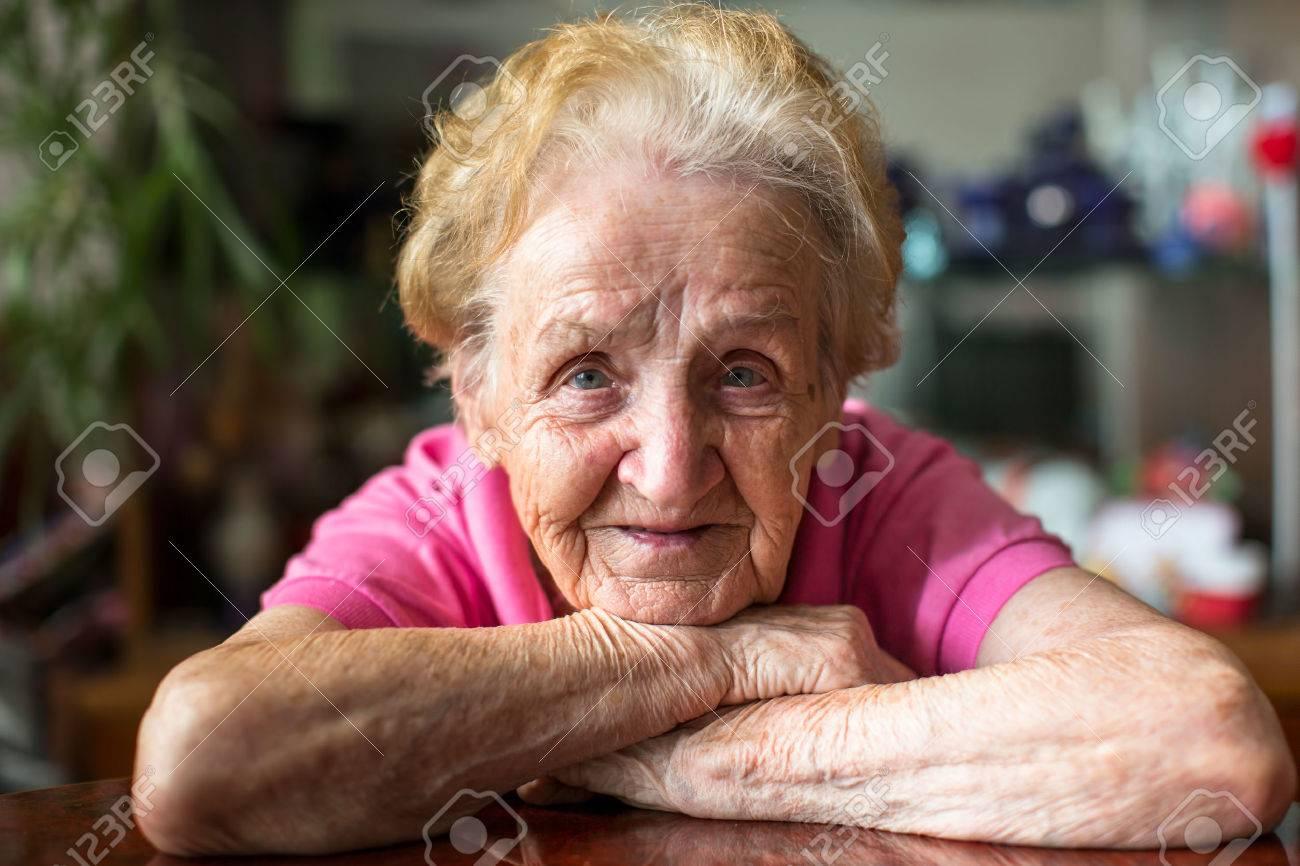 Closeup portrait of happy elderly woman. - 45240307