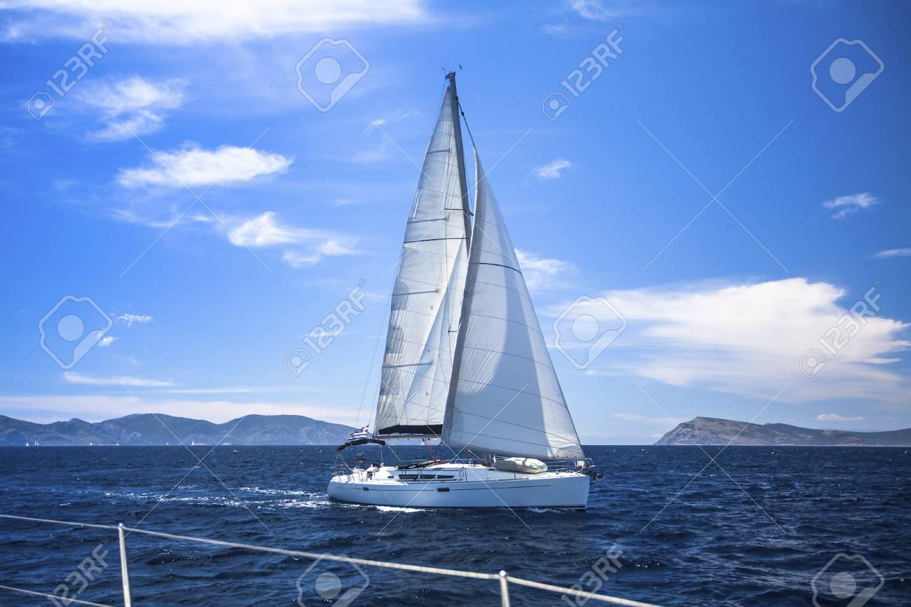Sailing  Yacht sails with beautiful cloudless sky  Luxury yacht