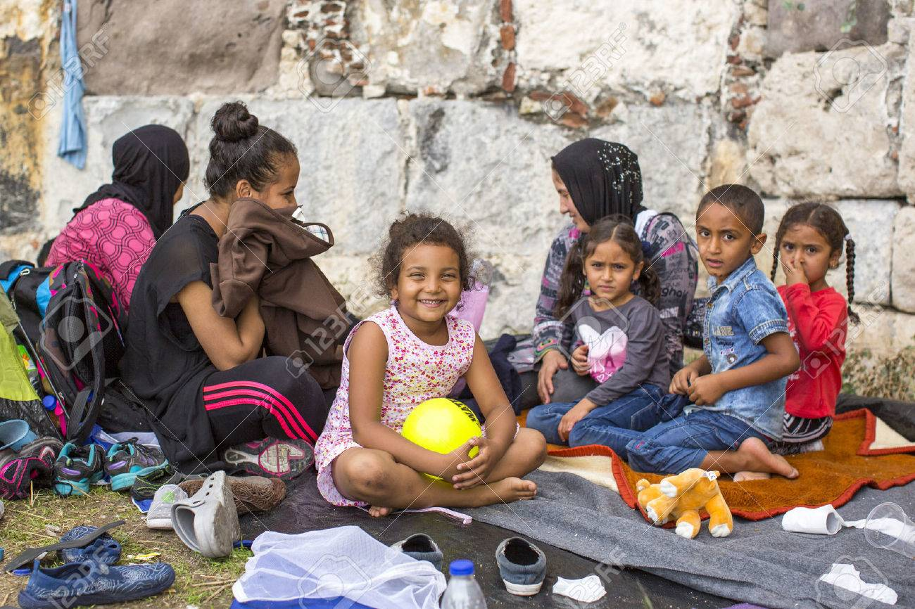 KOS, GREECE - SEP 27, 2015: Unidentified children war refugees. Kos island is located just 4 kilometers from the Turkish coast, and many refugees come from Turkey in an inflatable boats. - 45927126
