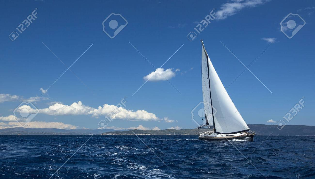 Ship yachts with white sails in the open Sea. Sailing luxury boats. - 46729041