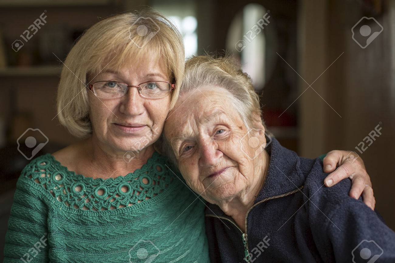 Portrait of an old woman with her adult daughter. - 46618712