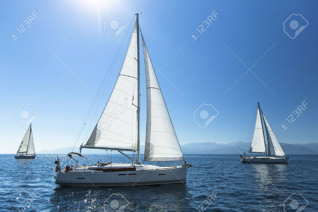 Sailing regatta. Sailing in the wind through the waves. Luxury yachts. - 47683411