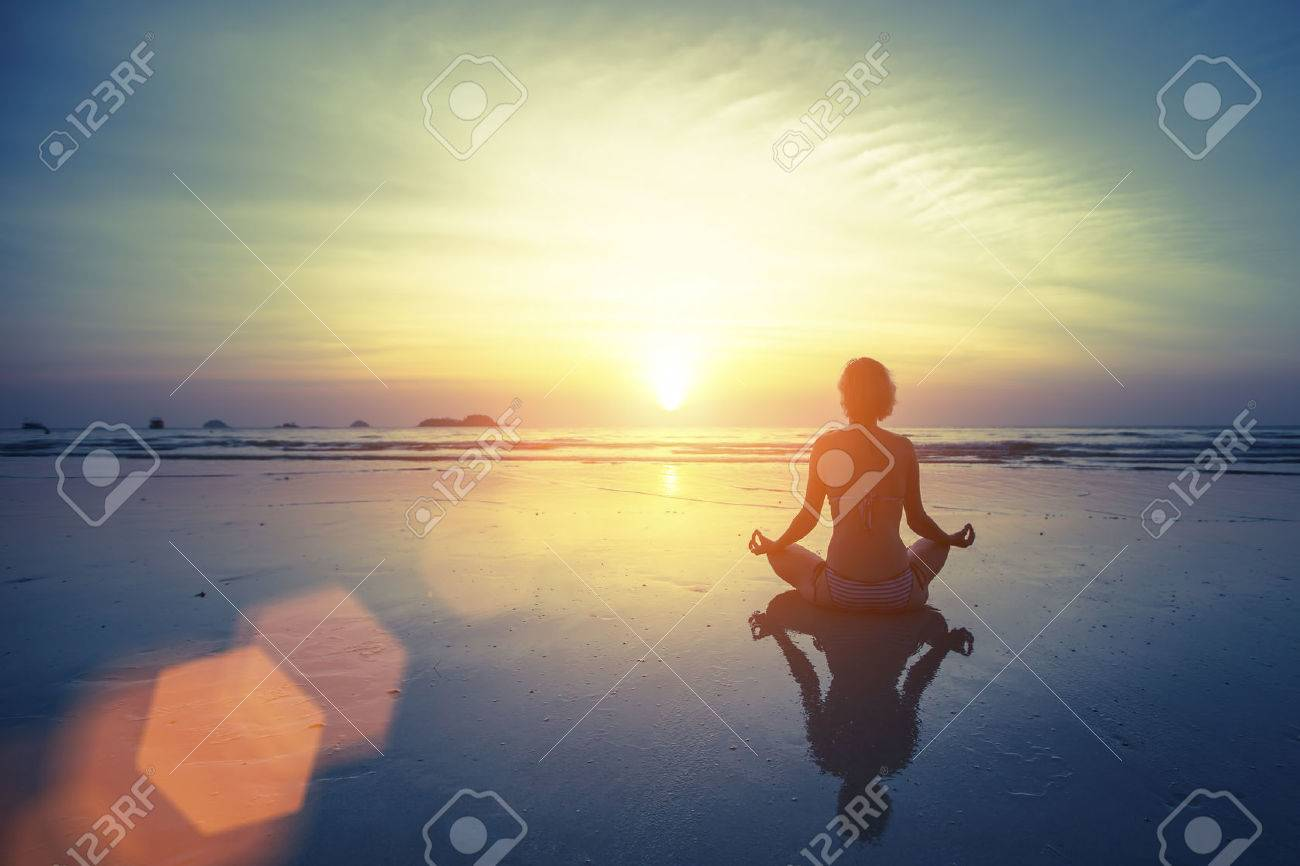 Silhouette meditation yoga woman on the background of the sea and amazing sunset. Healthy lifestyle. - 48954944