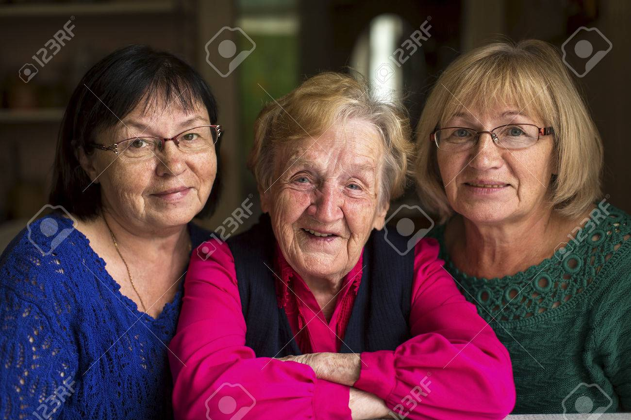 An old woman with two adult daughters. - 50736170