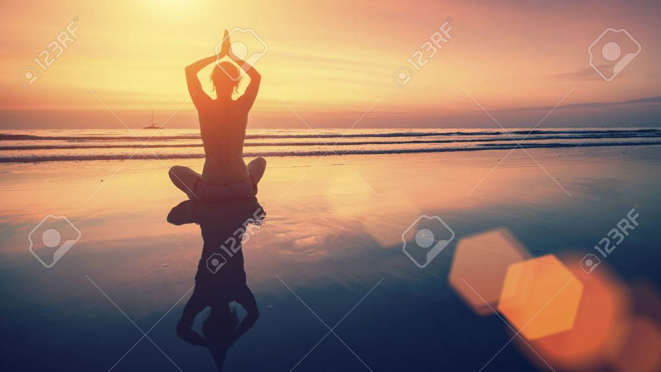 Amazing Yoga Background Silhouette Of Woman On The Beach At Stock Photo Picture And Royalty Free Image Image 59139820