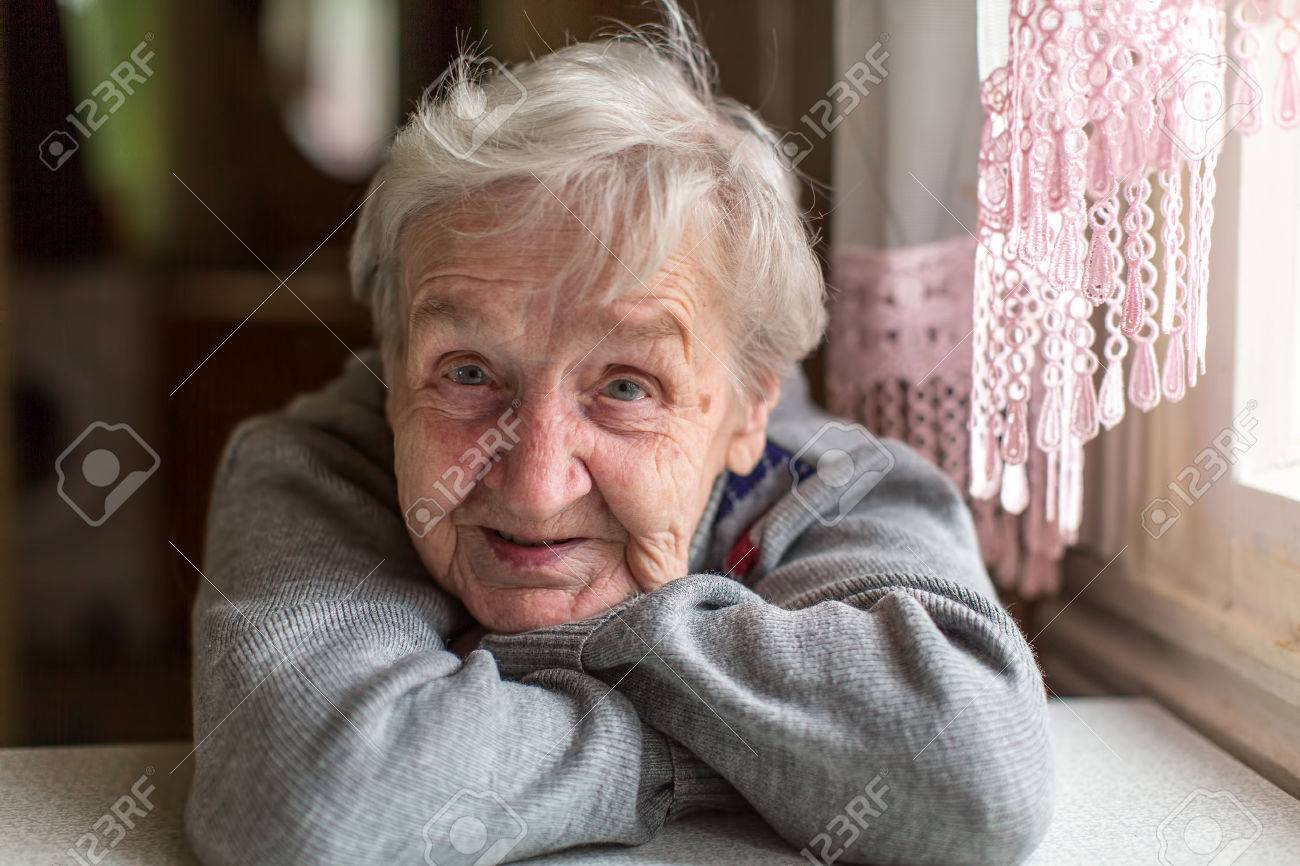 Portrait of an elderly woman, close-up, sitting at the table. - 59139897