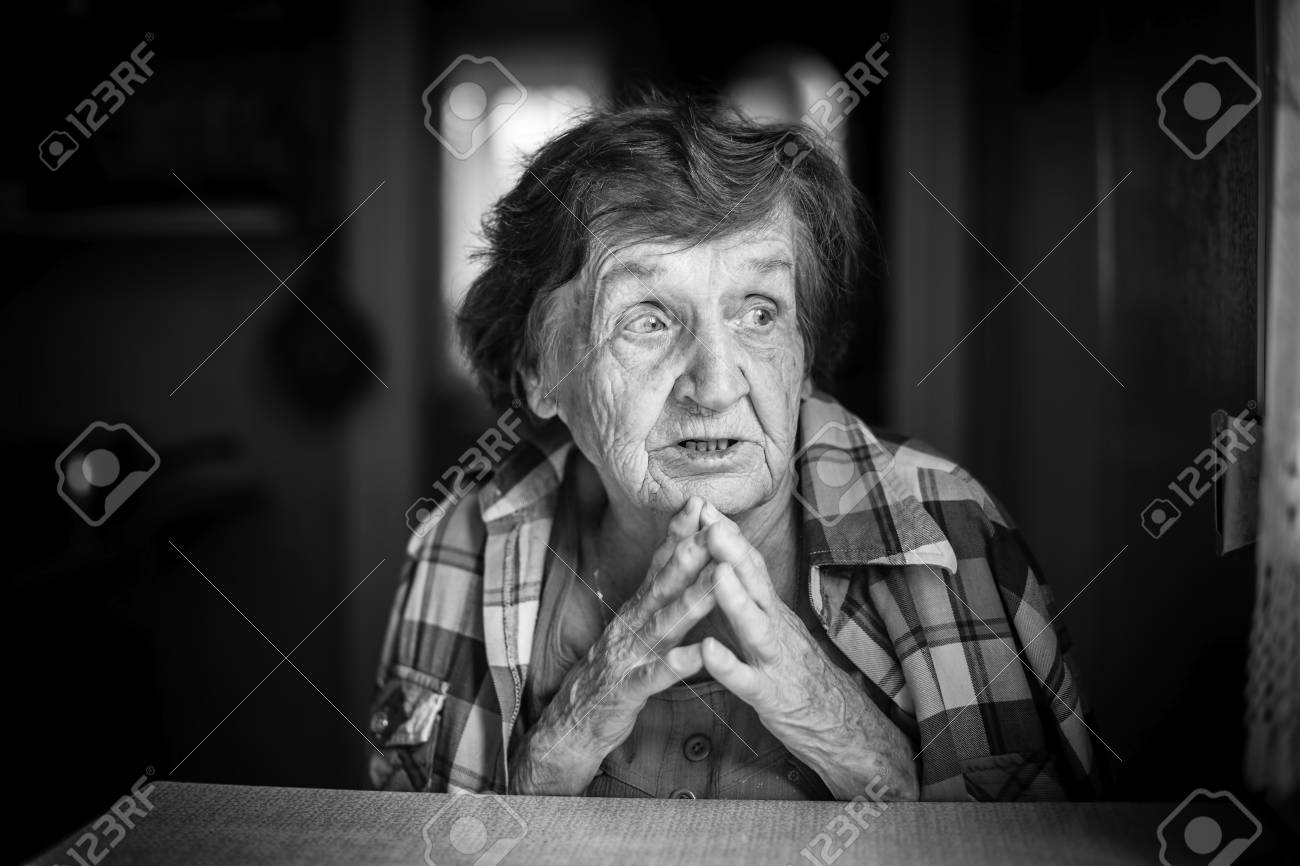 Emotional portrait of an elderly woman black and white photo stock photo 74481568