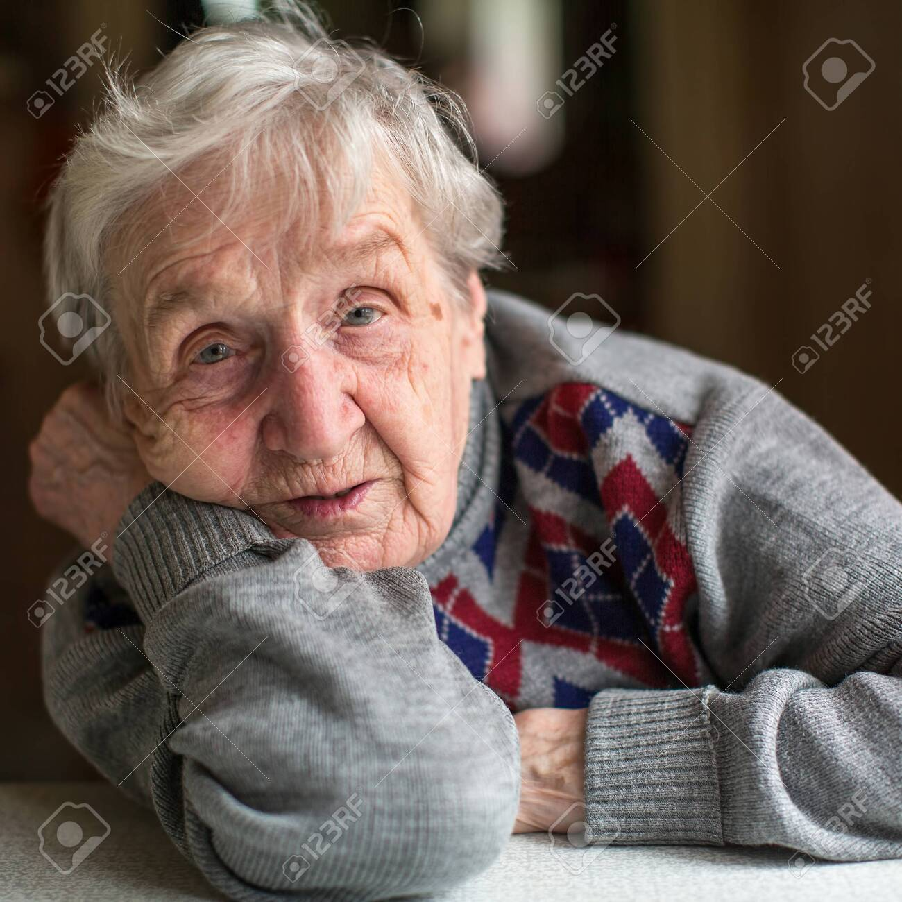 Portrait of a old woman. Close-up in her home. - 146579187