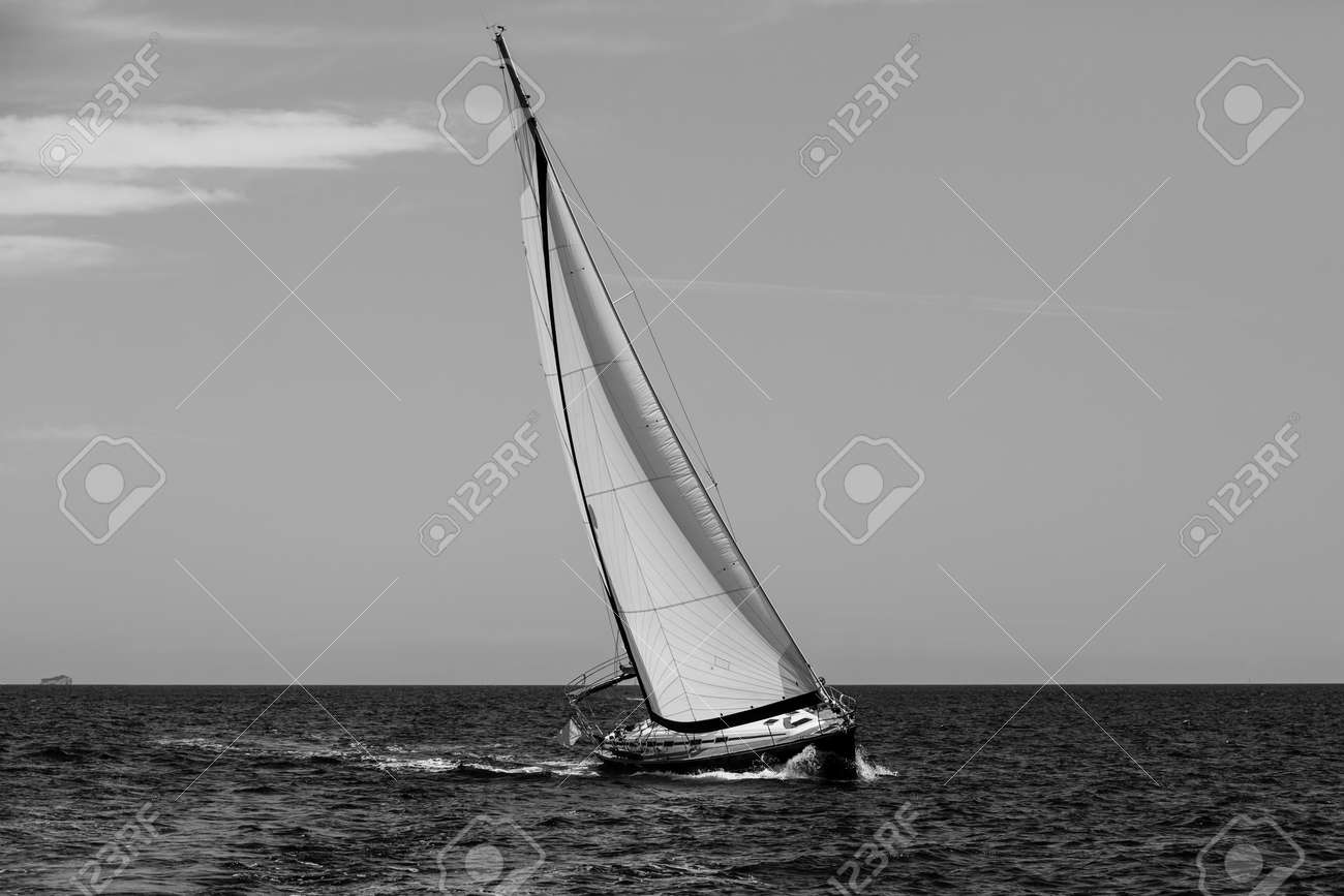 Luxury yachts. Sailing in the wind through the waves at the Aegean Sea. Black and white photo. - 156970483